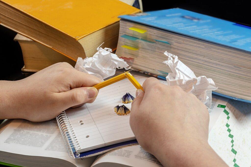 books, pencil, hands